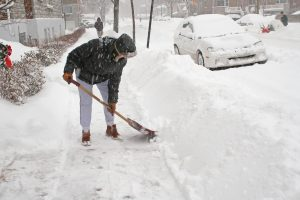 Prevent Back Pain While Shoveling